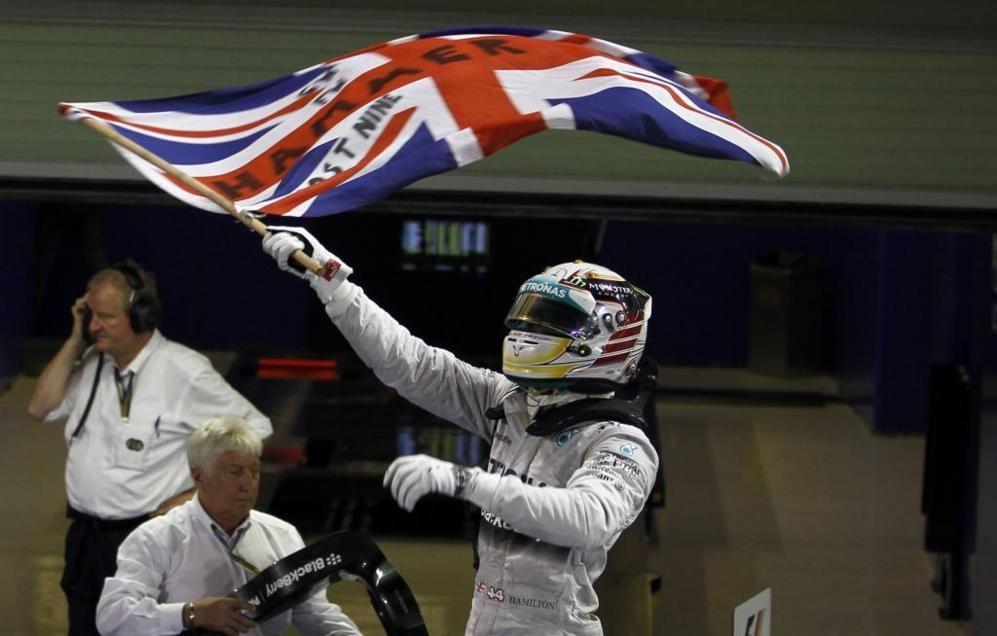 Mercedes Formula One driver Lewis Hamilton of Britain waves the Union...