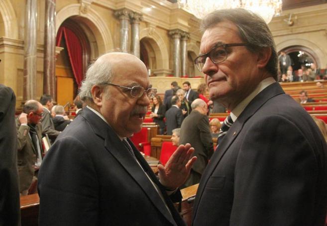 El president, Artur Mas, junto al conseller de Economia, Andreu...
