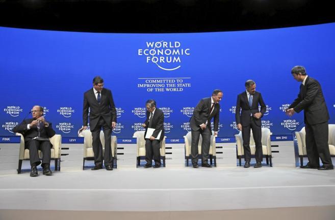 Representantes del CE, el FMI y BlackRock, ayer en la reunión del...