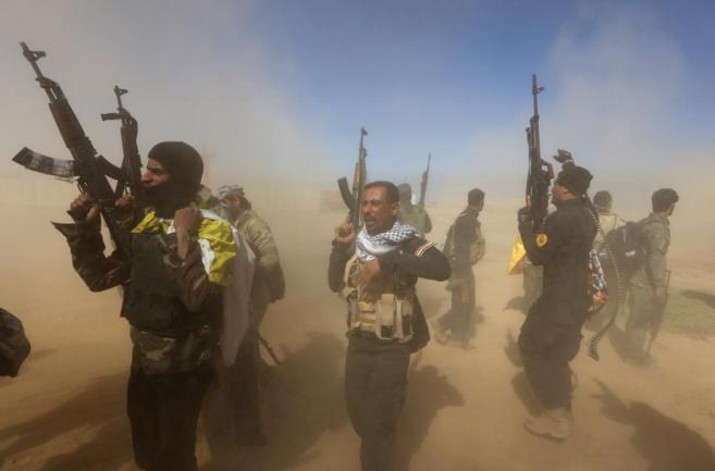 Combatientes de las milicias chiíes participan en la ofensiva para...