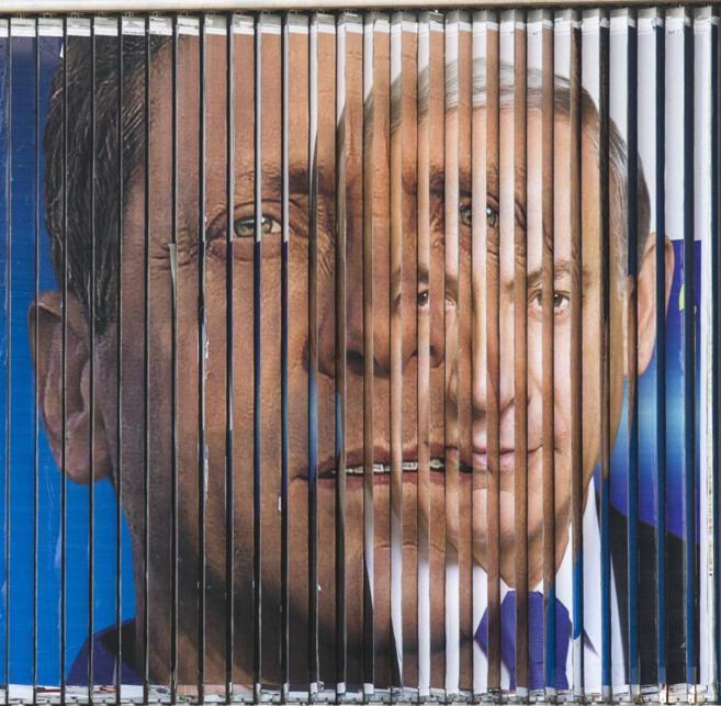 Un cartel gigante rota los rostros de Benjamin Netanyahu e Isaac...