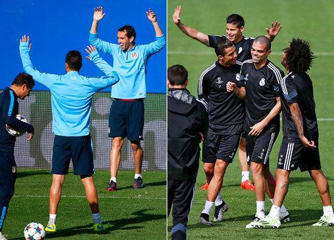 Jugadores del Atlético y el Real Madrid, durante los entrenamientos...