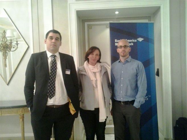 Un representante de Bank of America, junto a los dirigentes de Podemos...