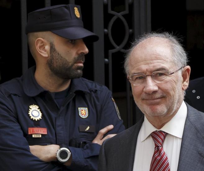 Rodrigo Rato, al abandonar su despacho, este viernes.