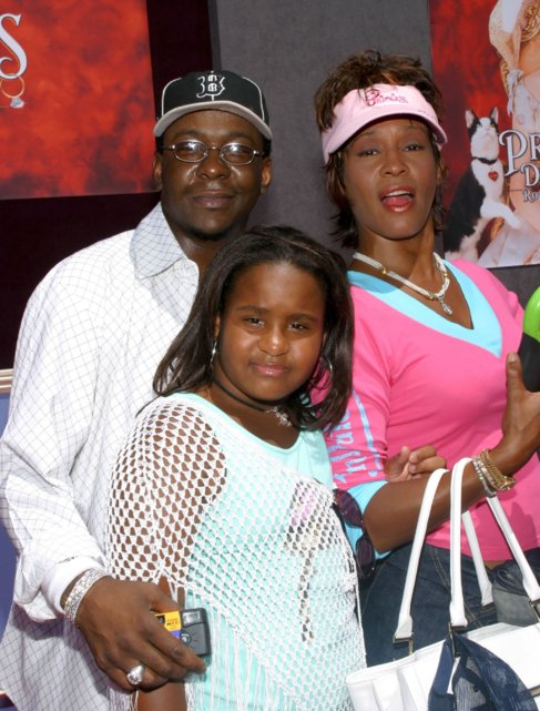 Bobby Brown, con Whitney Houston y su hija Bobbi Kristina en 2004