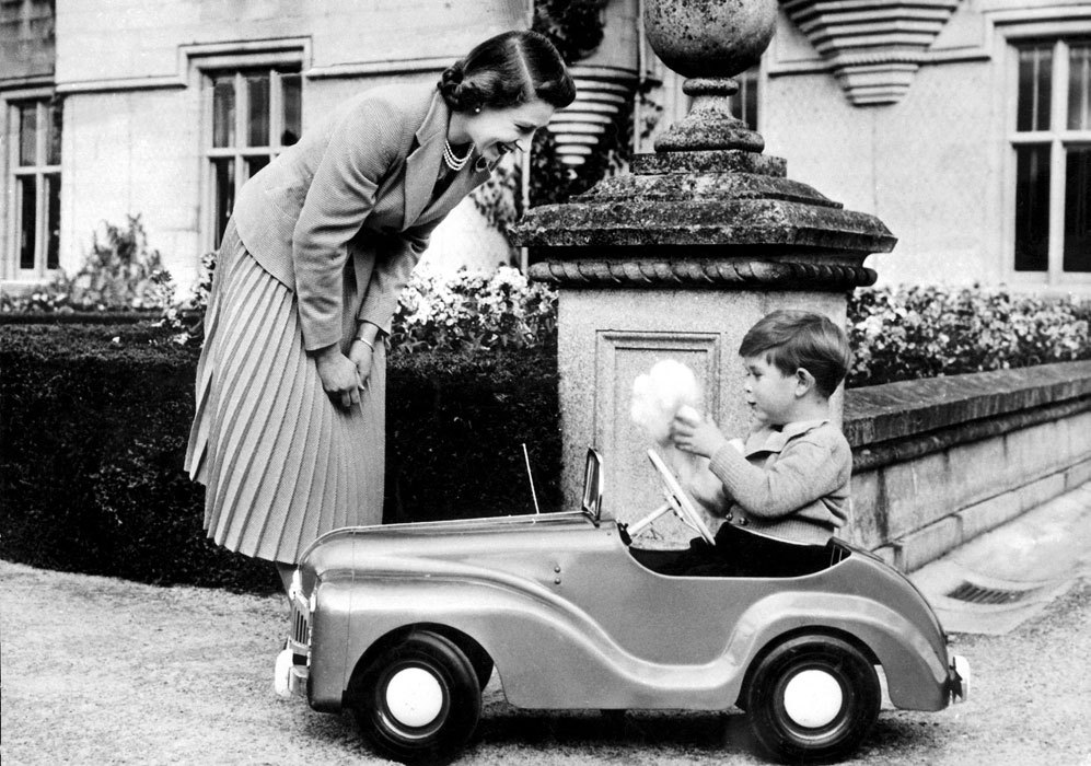 En la imagen, con su hijo mayor, Carlos.