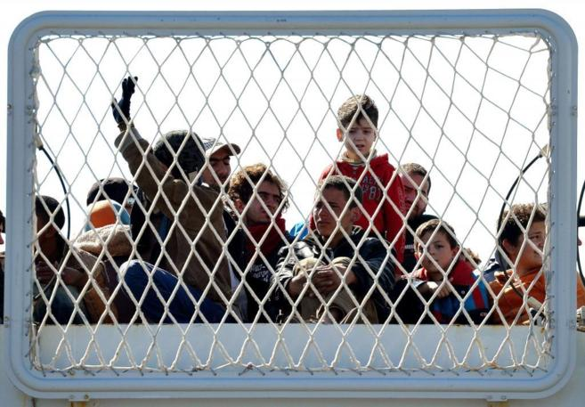 Inmigrantes llegados a la costa de Sicilia.
