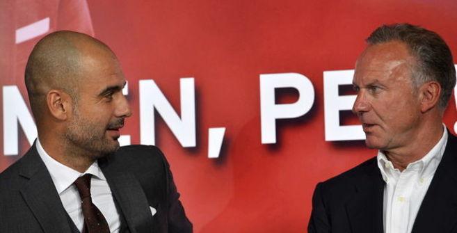 Pep Guardiola y Karl-Heinz Rummenigge.