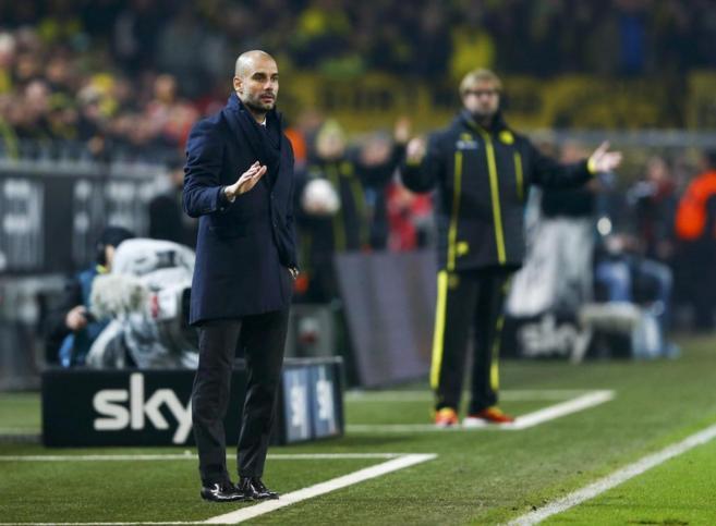 Guardiola y Klopp, durante un partido de la Bundesliga entre Bayern y...