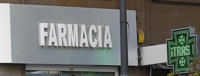 Cartel de una oficina de farmacia en la ciudad de Valencia.