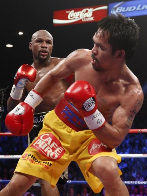 Mayweather y Pacquiao durante su combate en Las Vegas.