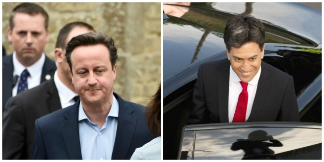 David Cameron y Ed Miliband tras votar en la mañana del 7 de mayo
