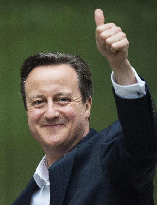 David Cameron saluda a los medios este viernes por la mañana, a su...