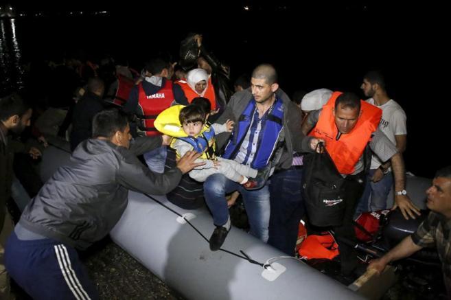 Refugiados sirios al llegar a la isla de Kos, en Grecia.