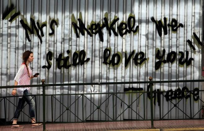 Grafiti en una calle de Atenas sobre Angela Merkel