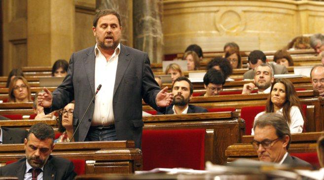 Oriol Junquerasy Artur Mas en una sesión de control en el Parlament.