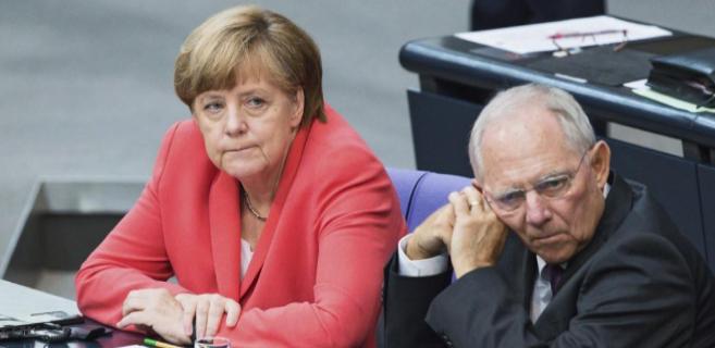 Angela Merkel y Wolfgang Schäuble este viernes en el Parlamento...