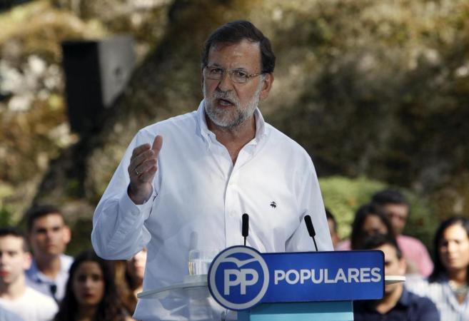 Rajoy durante su intervención en el acto del partido celebrado ayer...