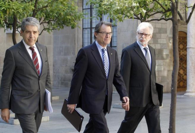 El president Artur Mas , Francesc Homs y Viver Pi-Sunyer en la...