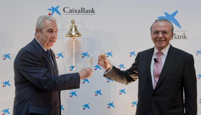El Presidente de Caixa Bank (d) y el presidente de la Bolsa (i)...