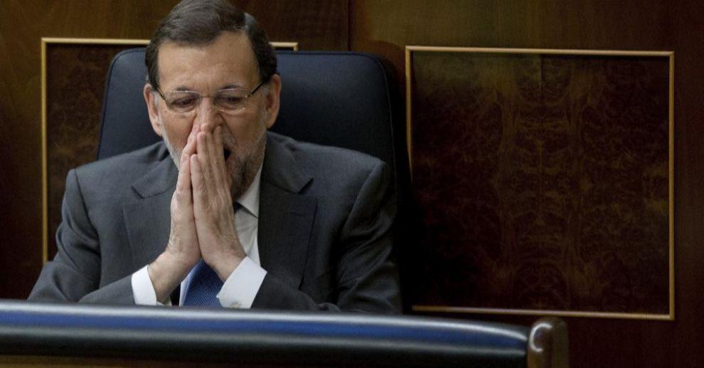 Mariano Rajoy disimula un bostezo durante un debate en el Congreso en...