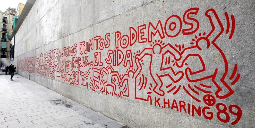 Mural con el lema 'Todos juntos podemos para el sida'.