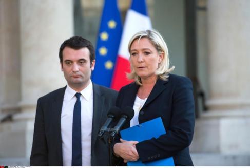 La presidenta del Frente Nacional francesa, junto a su vicepresidente,...