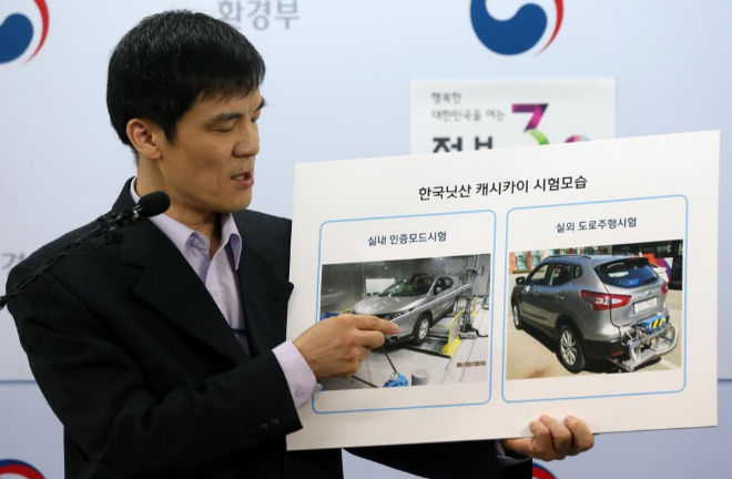 An official of South Korea's transort ministry holds a placard showing...