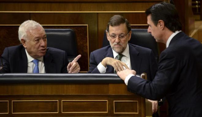 José Manuel García-Margallo, Mariano Rajoy y José Manuel Soria, en...