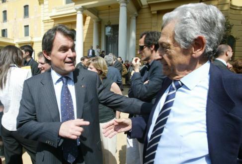 El ex presidente de la Generalitat Artur Mas junto a Artur Suqué, el...