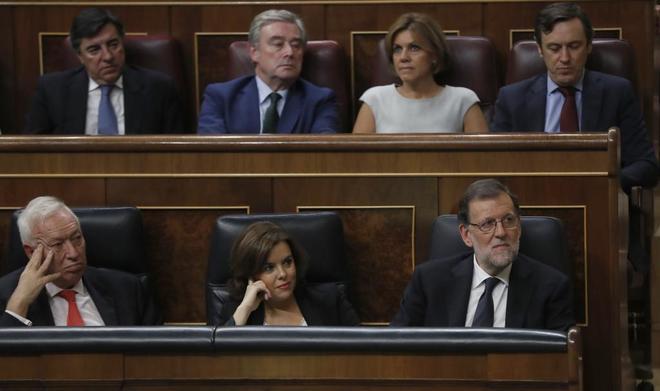 José Manuel García-Margallo, junto a Soraya Sáenz de Santamaría y...