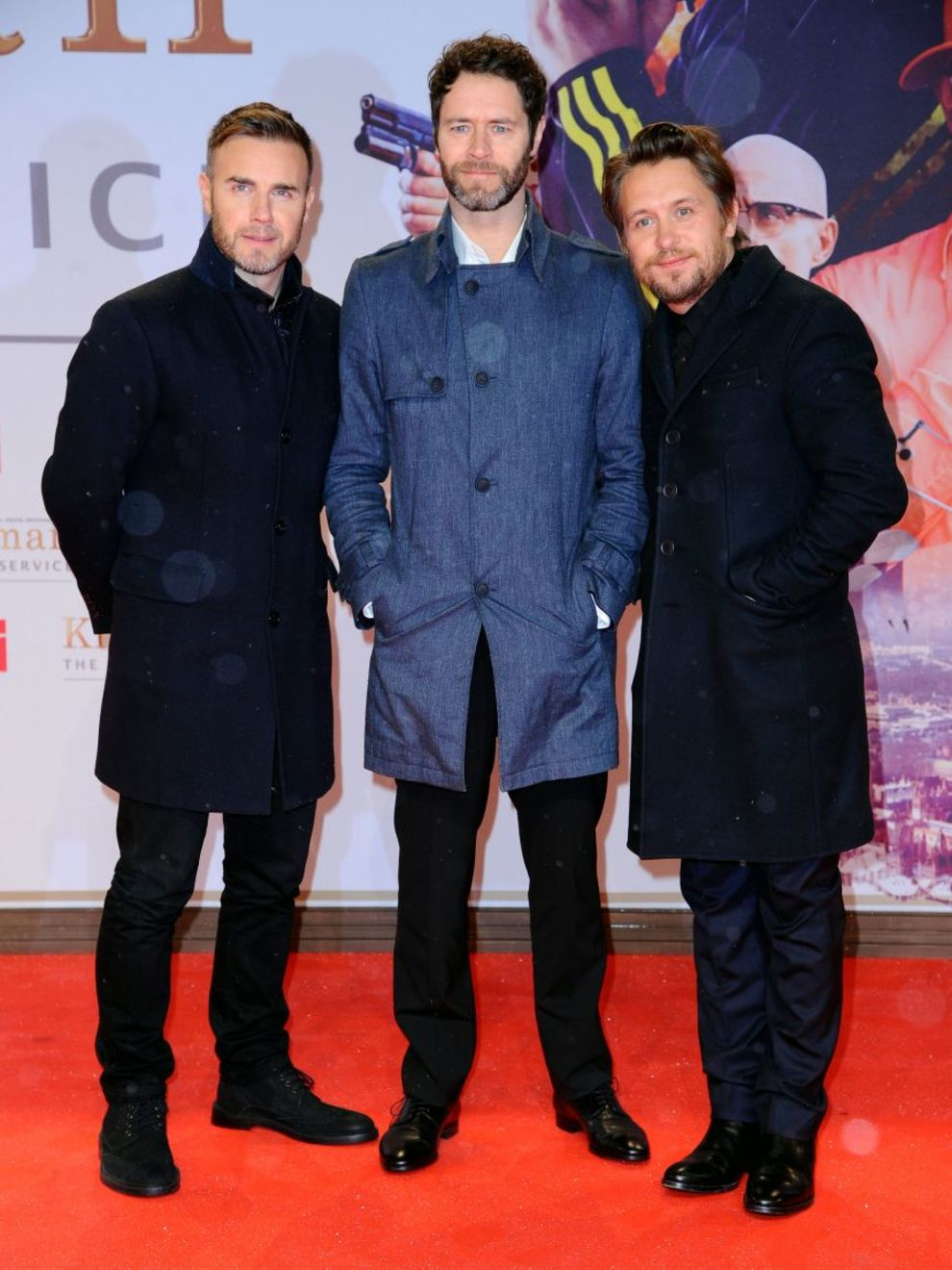 La banda de música Take That, compuesta por Gary Barlow, Mark Owen y...
