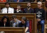 Los diputados de Podemos durante el discurso del Rey Felipe VI en la...
