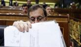 Rajoy, ayer, en su escaño del Hemiciclo, durante la sesión de...