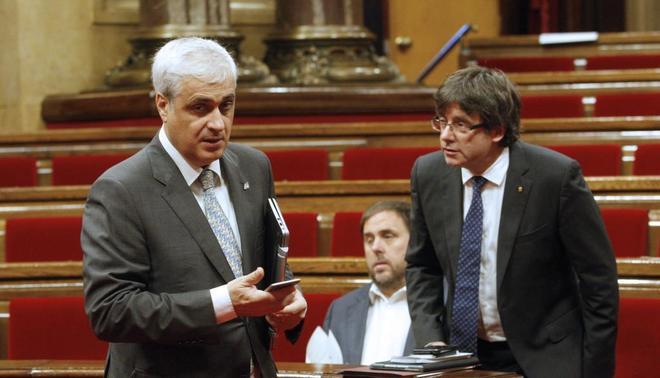 Germà Gordó, junto a Carles Puigdemont y Oriol Junqueras, en un...