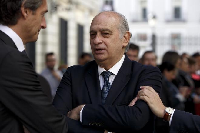 Jorge Fernández Díaz, junto al ministro Íñigo de la Serna, en la...