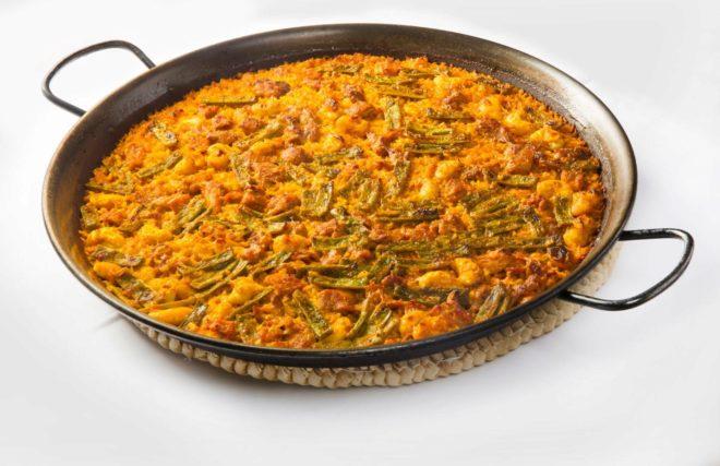 Aprende a preparar paella valenciana papel el mundo - Como cocinar paella ...