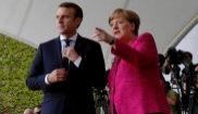 Emmanuel Macron y Angela Merkel, ante los periodistas en el primer...