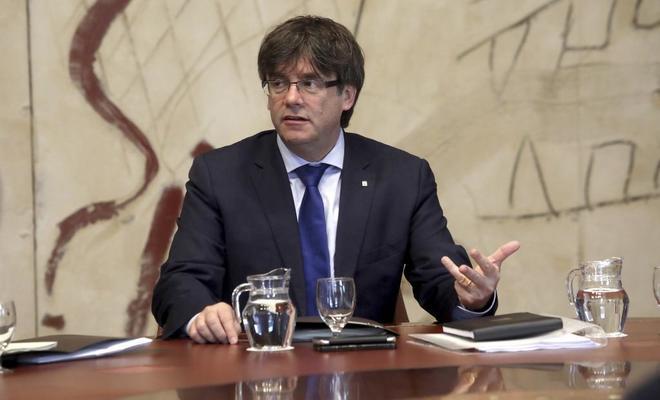 El presidente de la Generalitat, Carles Puigdemont, ayer, en la...