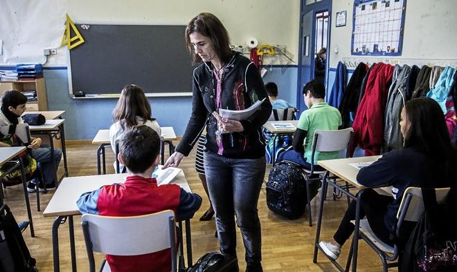 Menores realizan la prueba de 6º de Primaria en un colegio público de la Comunidad de Madrid.