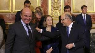 Luis de Guindos y Cristóbal Montoro