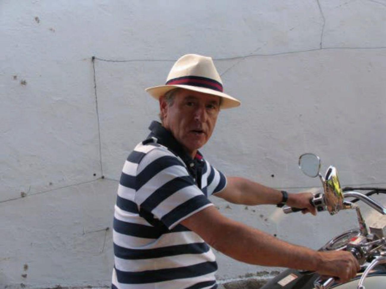 El ex presidente de  Caja Madrid, Miguel Blesa, en moto, durante una...