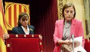 Carme Forcadell, presidenta del Parlament, toma asiento ayer durante...
