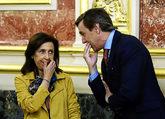 Los portavoces en el Congreso del PSOE, Margarita Robles, y el PP,...