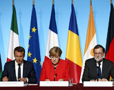 Emmanuel Macron, Angela Merkel y Mariano Rajoy, en una cumbre...