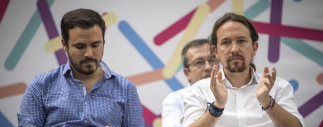 Alberto Garzón y Pablo Iglesias, en un acto en Zaragoza.