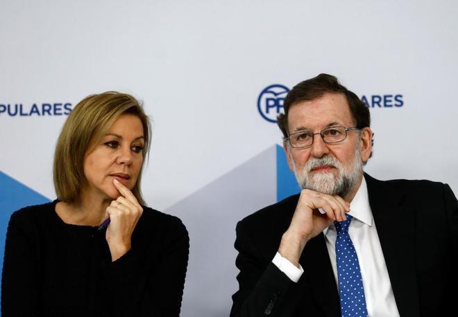 La ministra de Defensa, María Dolores de Cospedal, y el presidente...