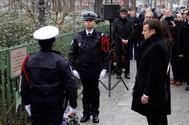 Emmanuel Macron durante el minuto de silencio, en el tercer aniversario de los atentados.