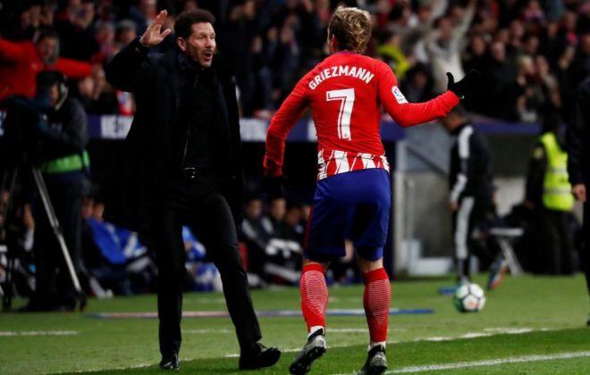 Griezmann con Simeone festeja uno de sus goles ante el Leganés.