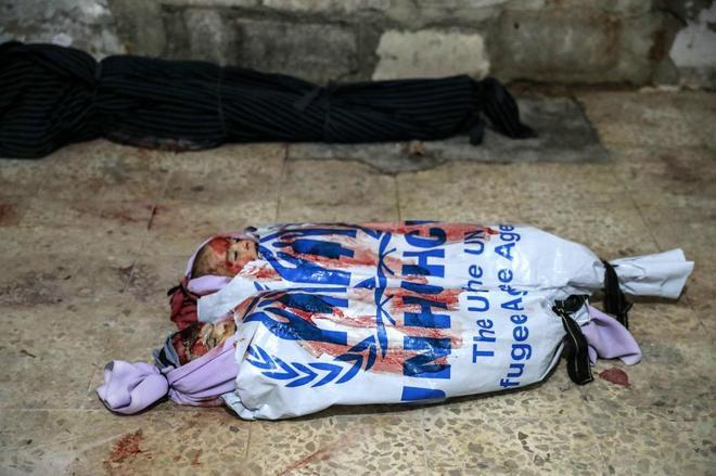 Amortajados con la bandera del fracaso humanitario